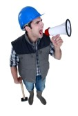 14194646-angry-tradesman-yelling-into-a-megaphone